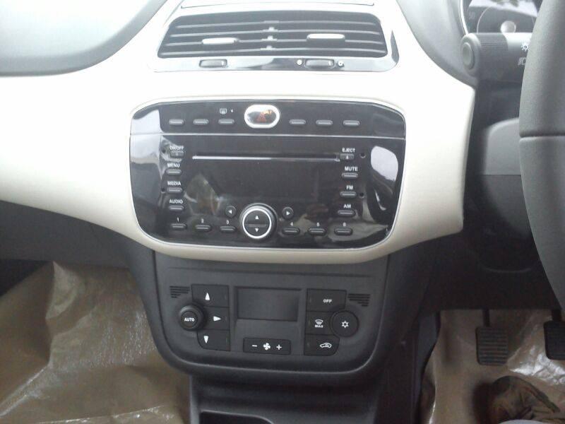 Fiat Punto Evo facelift arrives at dealerships; photos inside ...