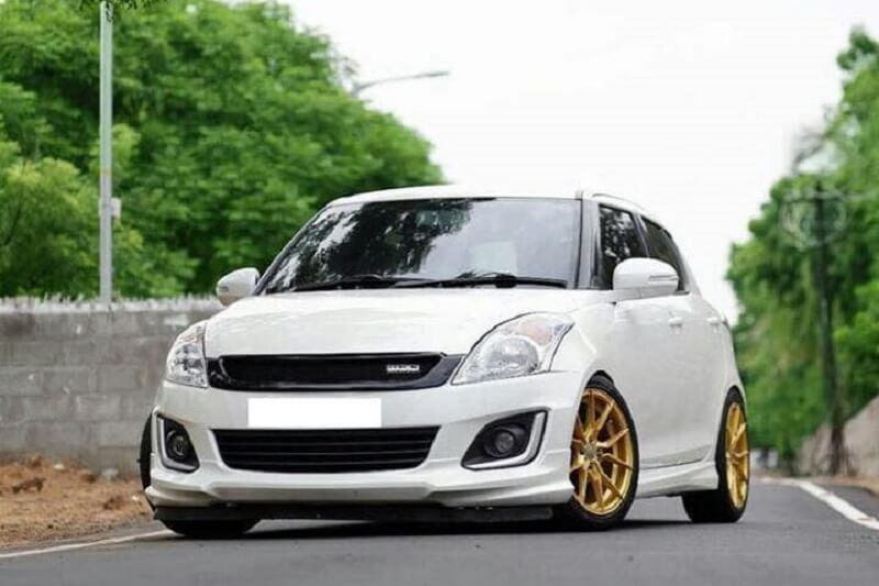 This Maruti Swift Goes All Blingy With Gold Alloy Rims